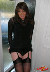 Tiny brunette crossdresser teasing in a pair of black nylons and matching dress to finish you off  tiny brunette crossdresser teasing in a pair of black nylons and matching dress to finish you off. Gorgeous brunette crossdresser teasing in a pair of black nylons and matching dress to finish you off
