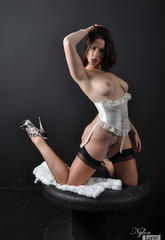 A lustful white corset covers this lustful babe and her petite curves  a lustful white corset covers this lustful babe and her petite curves. A horny white corset covers this horny babe and her tiny curves