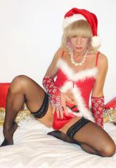 Xmas tgirl slut kim looks delicate in her miss santa outfit  xmas tgirl slut kim looks delicate in her miss santa outfit. Xmas tranny bitch Kim looks petite in her Miss Santa outfit