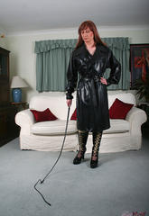 Ladyboy lucimay wearing long pvc coat with her whip  ladyboy lucimay wearing long pvc coat with her whip. Tgirl Lucimay wearing long pvc coat with her whip