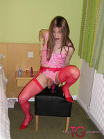 Tgirl kirsty wearing horny red lingerie and stockings riding her pink dildo toy  tgirl kirsty wearing horny red lingerie and stockings riding her pink dildo toy. TGirl Kirsty wearing horny red lingerie and stockings, riding her pink dildo toy