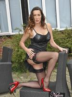 Preview Nylon Jane - Sexy Milf Nylon Jane is out in the garden in a hot black lingerie and silky nylon stockings