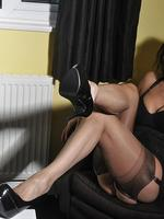 Preview Nylon Jane - Hot Milf Nylon Jane shows off her curves in her sexy nylon stockings, black lingerie and matching high heel shoes